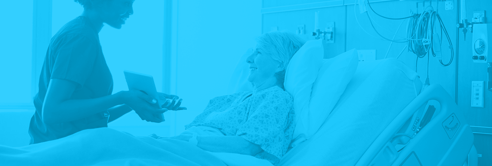 Nurse showing patient in bed her health chart on a tablet