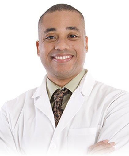 Male Doctor smiling with arms crossed