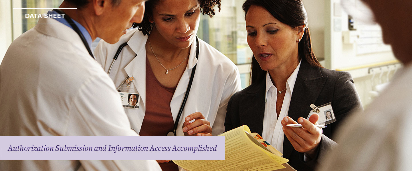 Group of medical staff talking and looking at a woman's clipboard